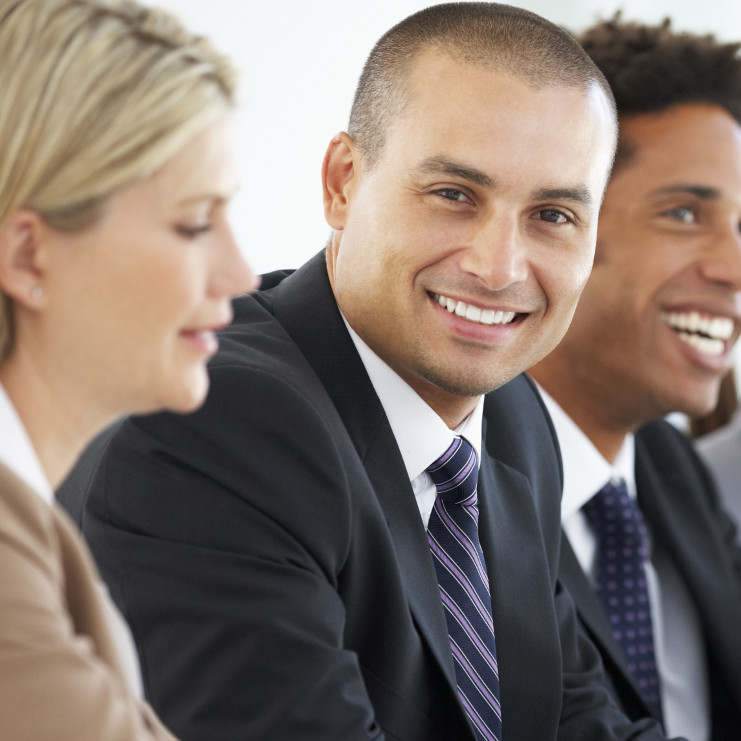 Photo of a diverse group of happy business people.