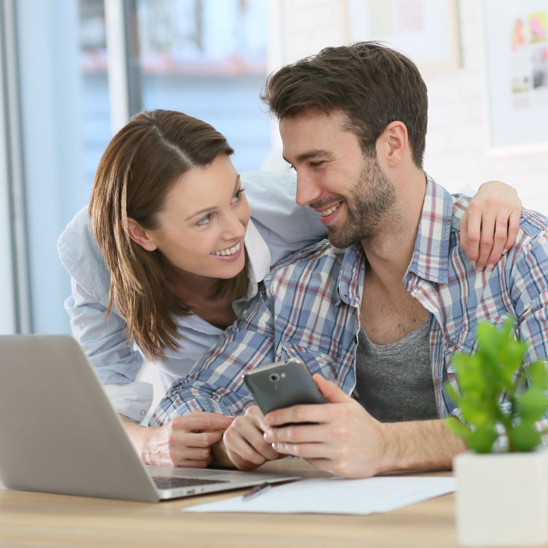 Photo of a couple applying online for a loan