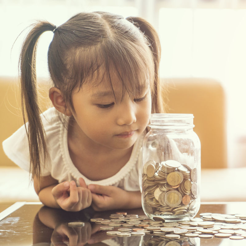 photo of girl and coin jar