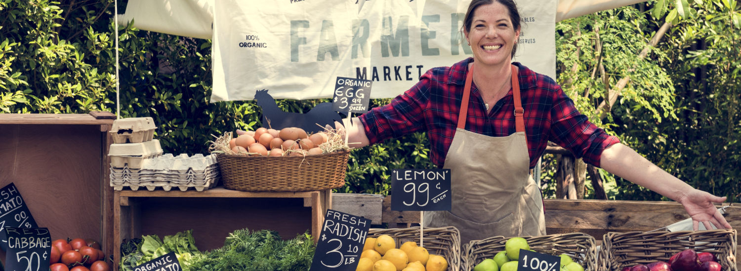 Photo of woman running a fruit stand
