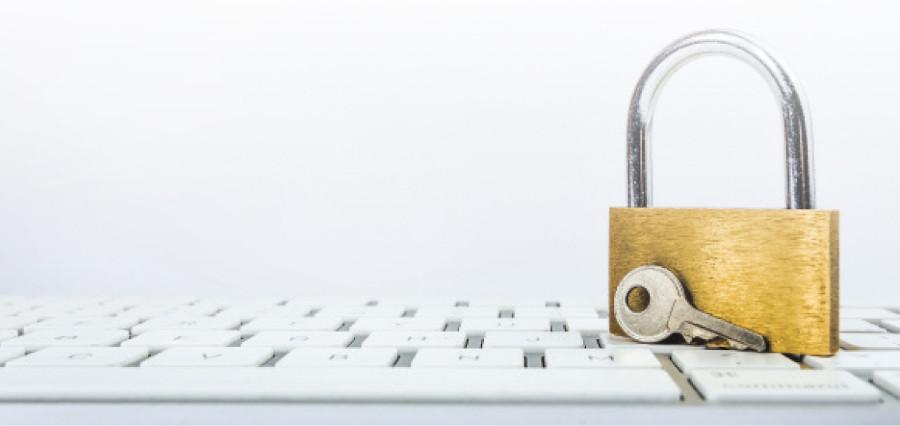Photo of a padlock and a computer keyboard