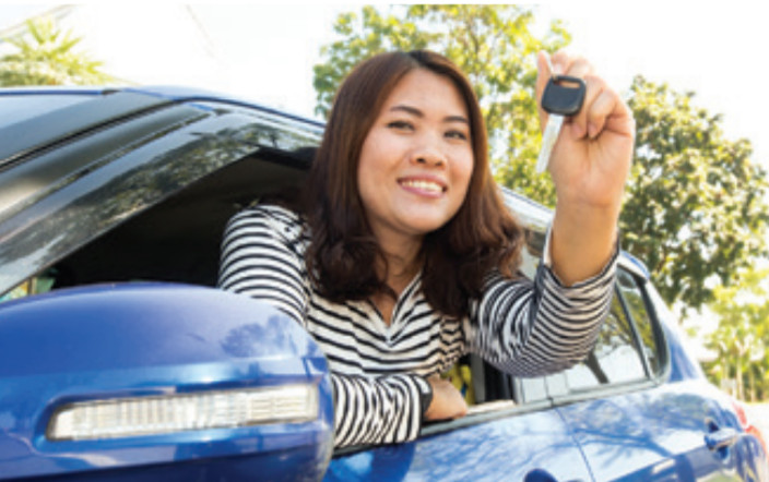 image of a woman enjoying her new car