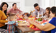 image of happy family eating a holiday meal