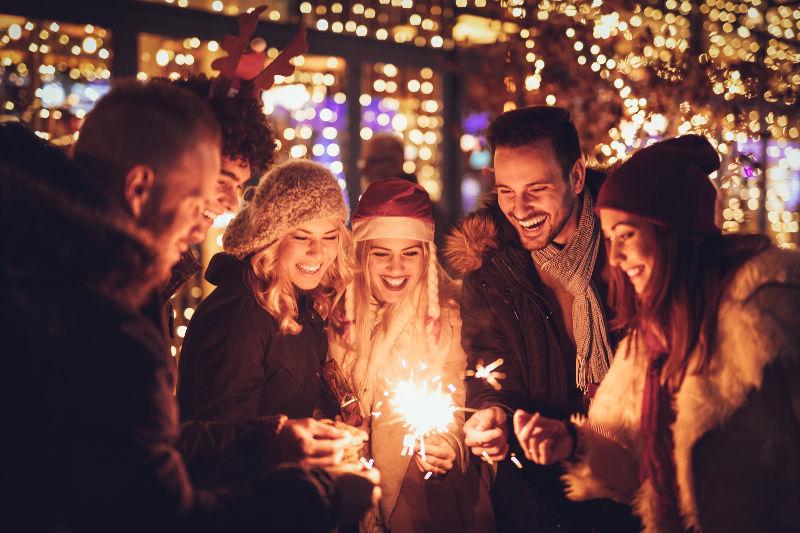 Friends celebrating winter holidays together